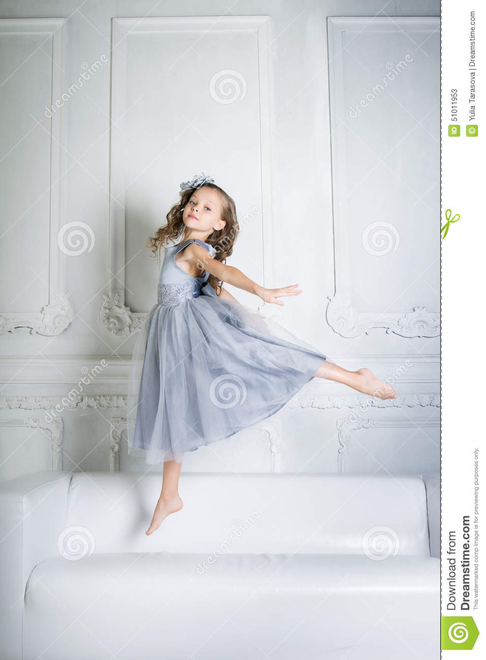 Beautiful Girl Is Jumping On The Sofa Stock Photo Image