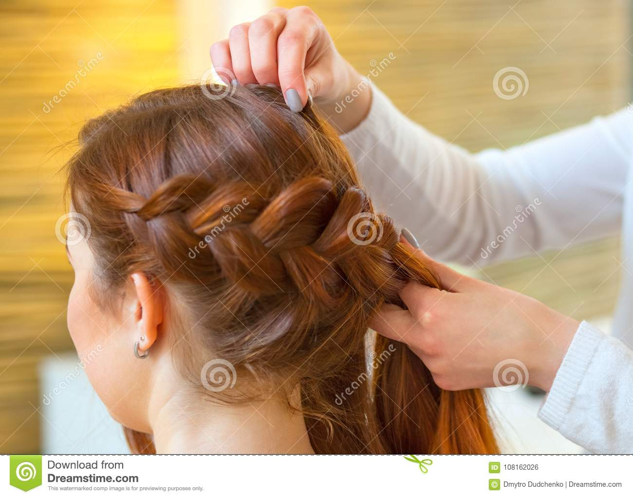 Beautiful Girl With Long Red Hair Hairdresser Weaves A Braid In A