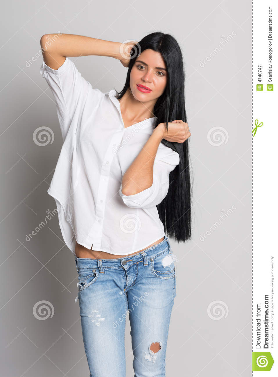 Beautiful Girl Model In Torn Jeans Stock Image