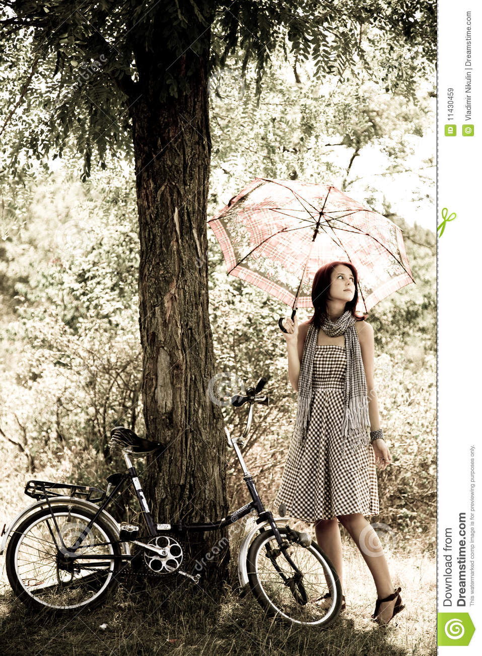 Beautiful Girl Near Bike Royalty Free Stock Images