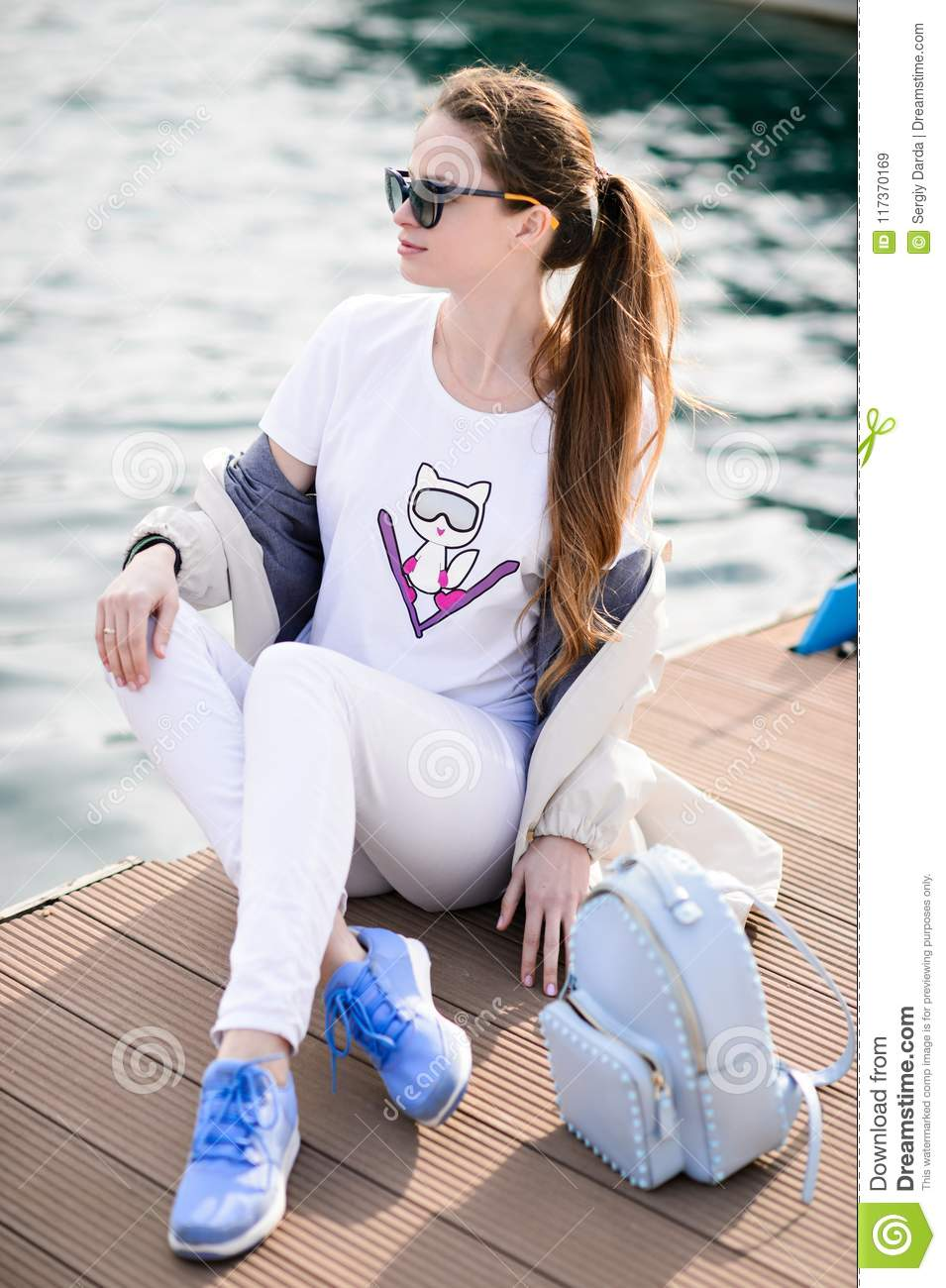 Beautiful girl outdoors. Spring day.
