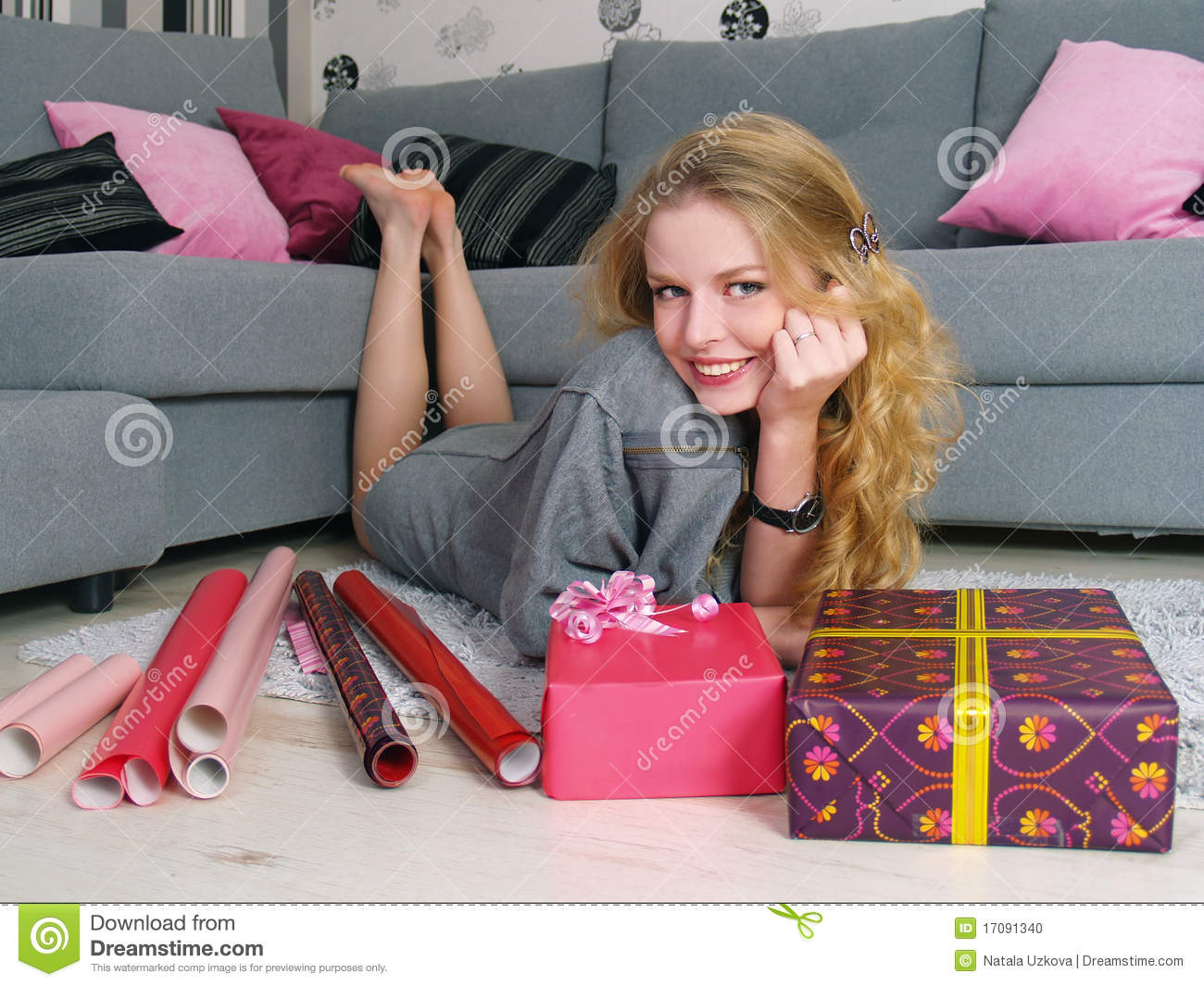 The beautiful girl packs gifts for a holiday