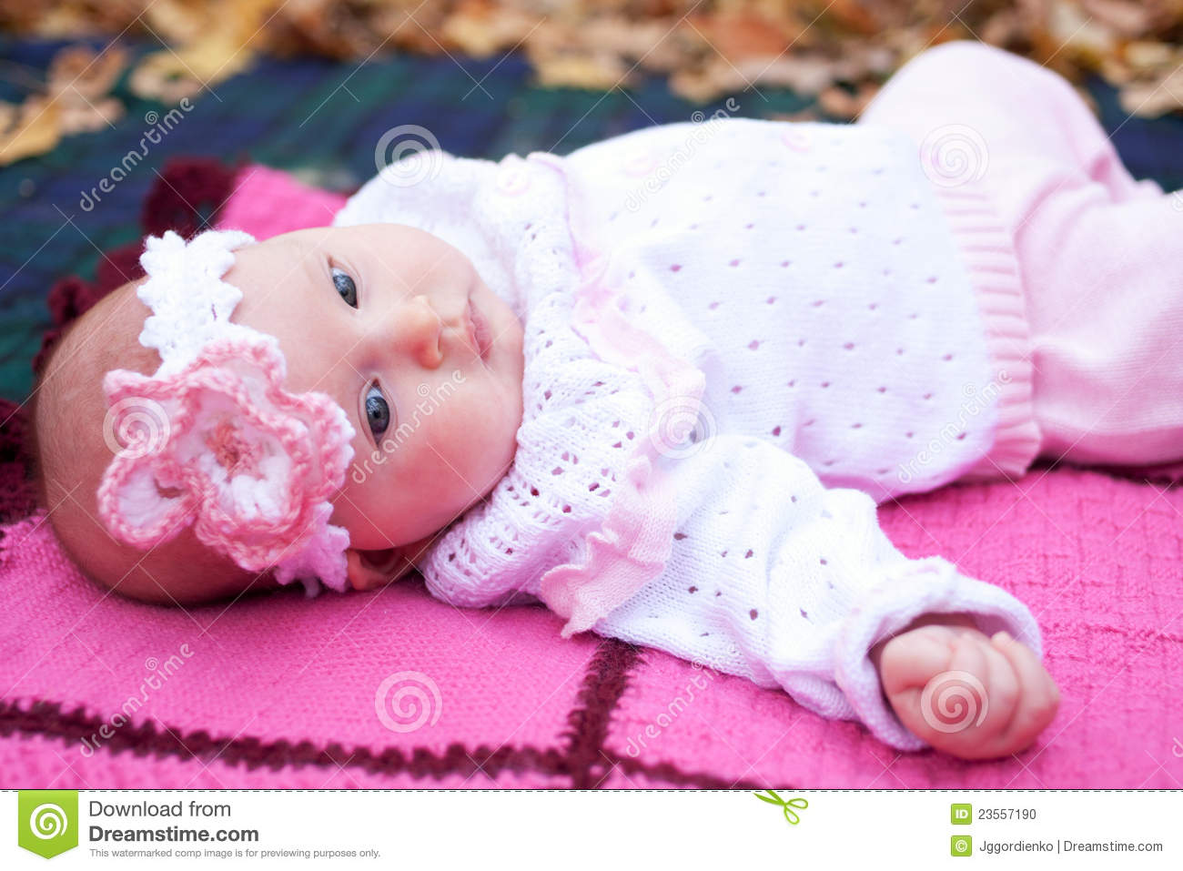 Beautiful Girl In A Pink Baby Clothes Stock Image