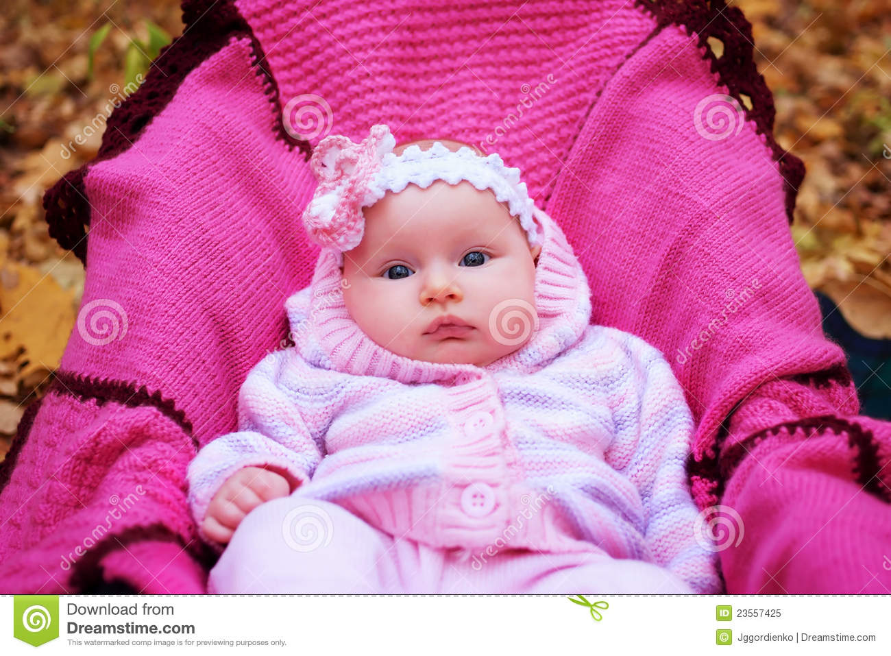 Beautiful girl in a pink baby clothes royalty free stock photo image 23557425