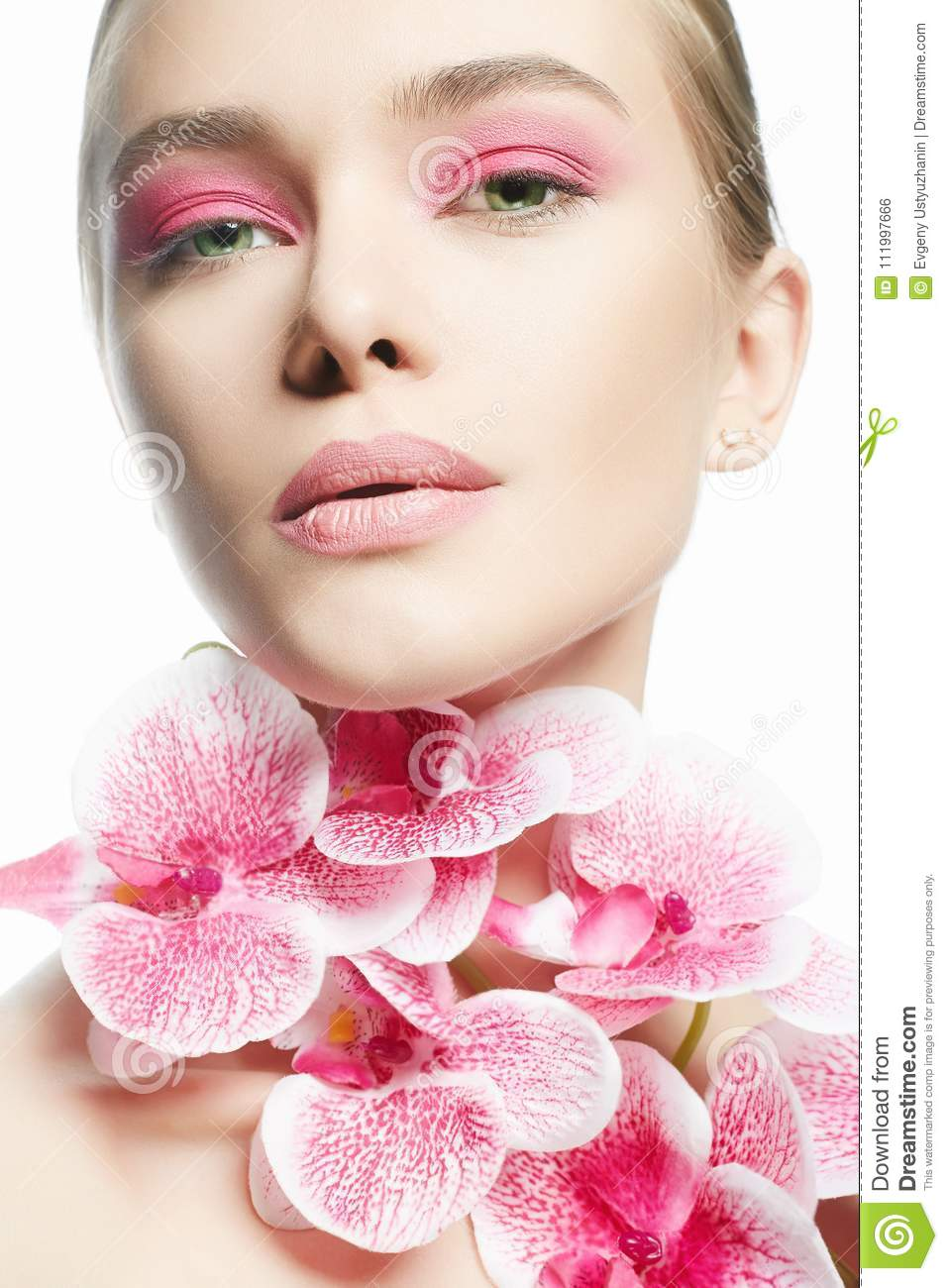 Beautiful girl with pink make up and flower stock photo image of beautiful young woman with pink make up and flower beauty portrait of girl with orchid flower clean skin face care izmirmasajfo