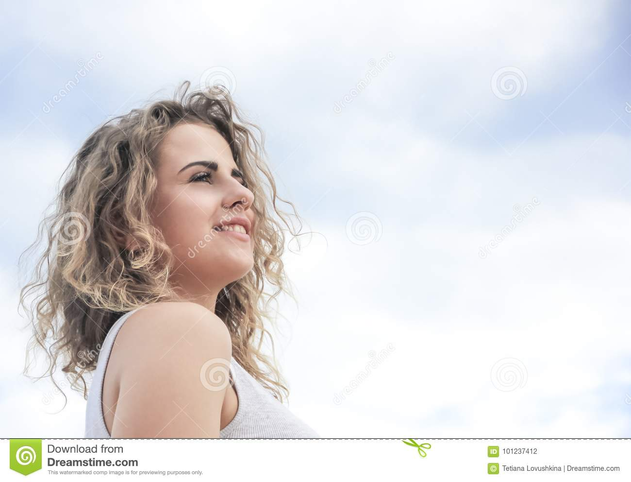 Beautiful girl portrait against the sky