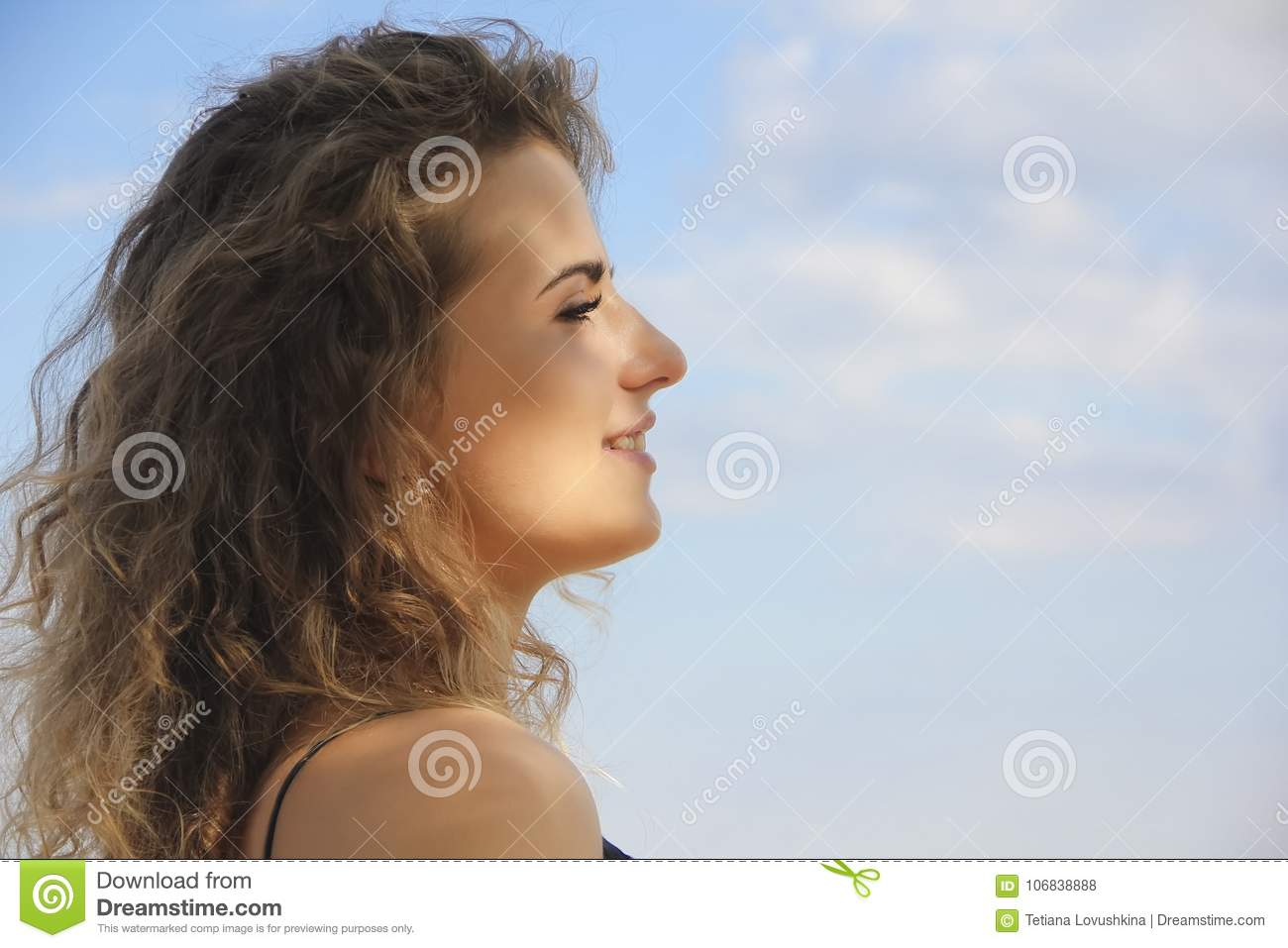 Beautiful girl portrait profile on the sea background