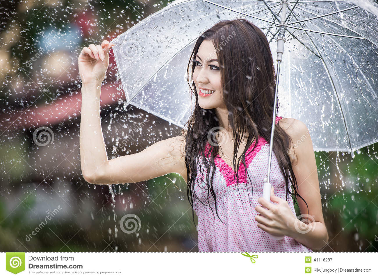 beautiful in the rain with transparent umbrella stock photo