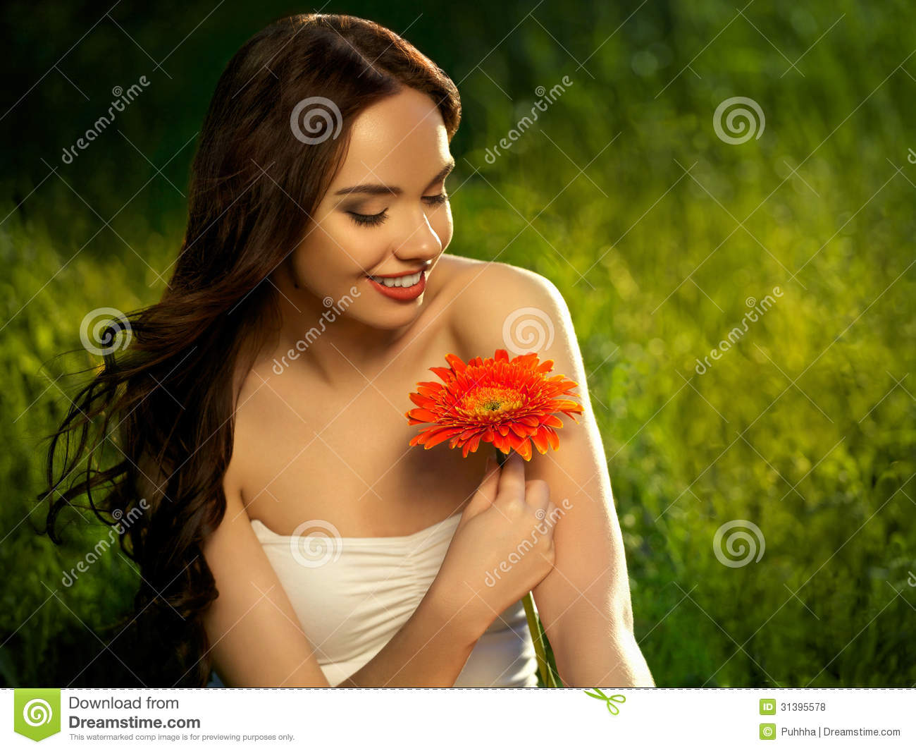 Beautiful Girl With Red Flowers. Beautiful Model Woman Face.