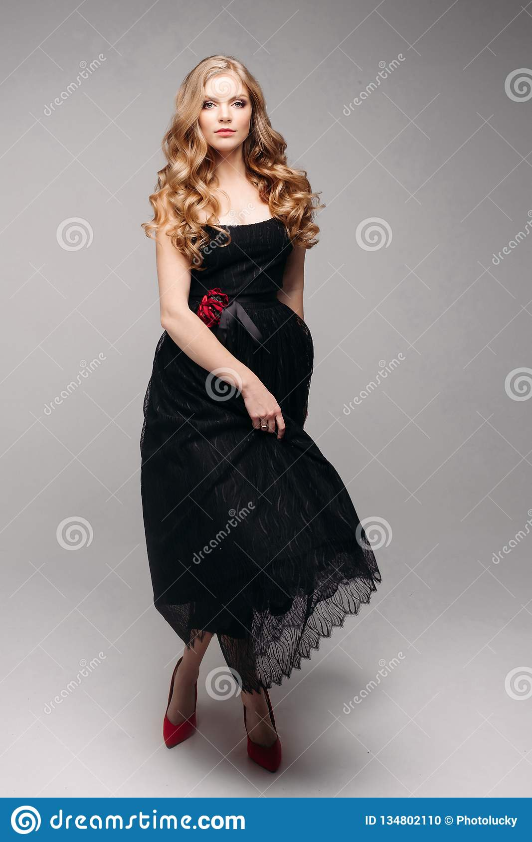 925db94e783 Beautiful Girl With Red Hair In Black Dress And Red Heels Stock ...