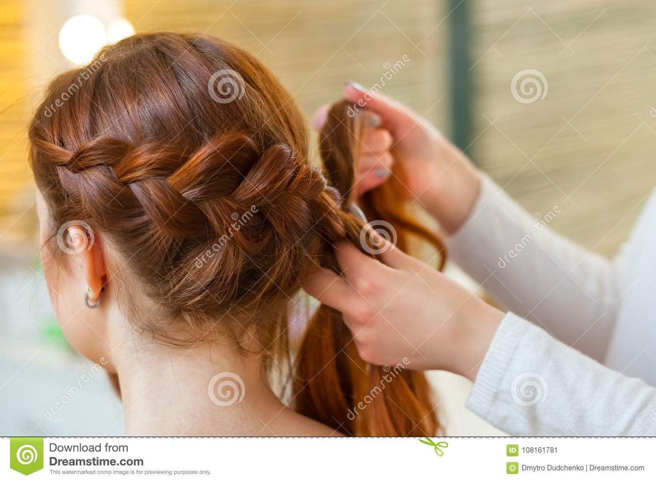 Beautiful Girl With Red Hair Hairdresser Weaves A Braid Close Up