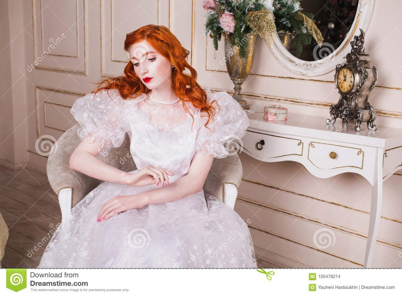 Beautiful Girl With Red Hair Stock Photo