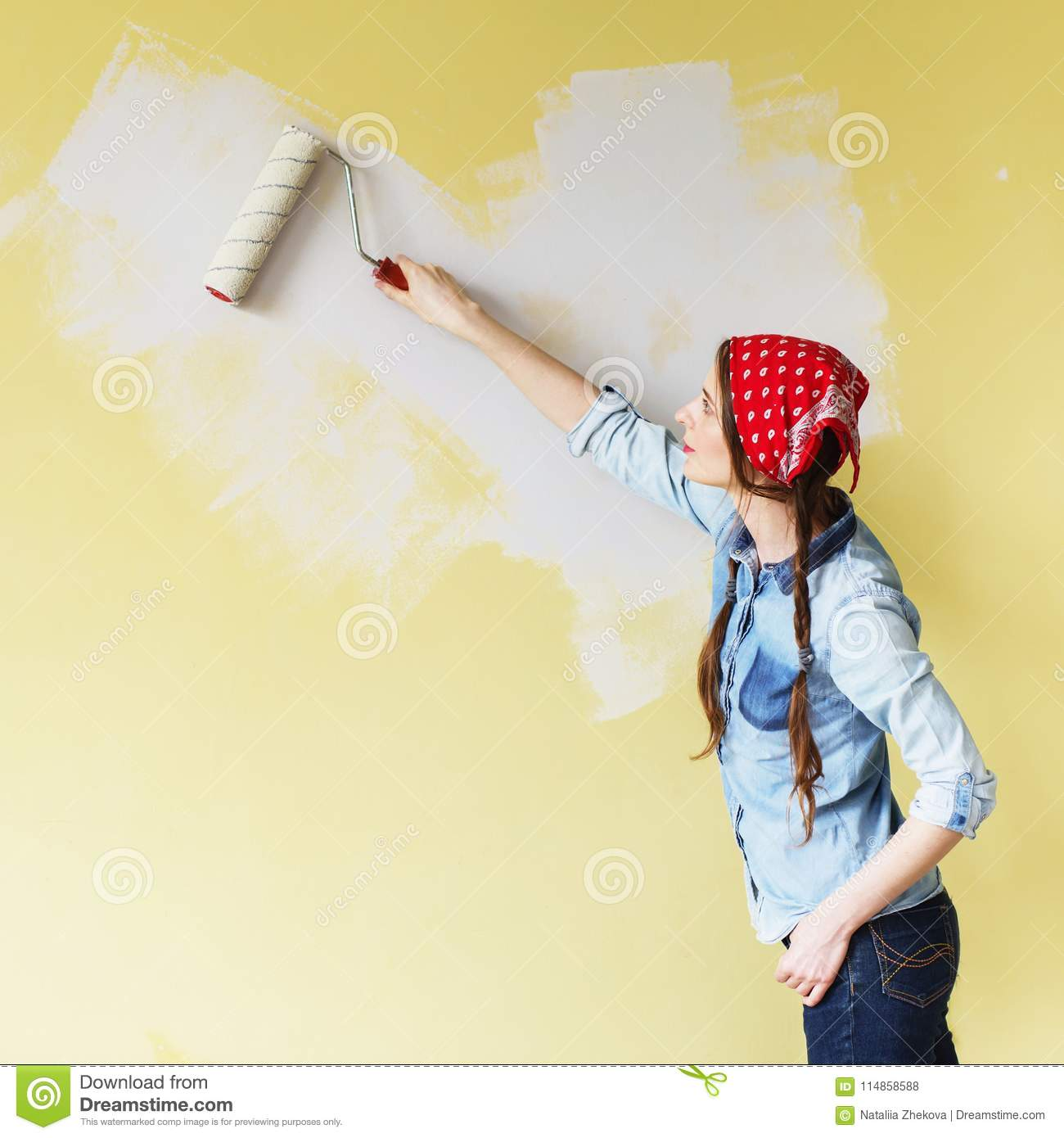 Beautiful Girl In Red Headband Painting The Wall With Paint Roll ...