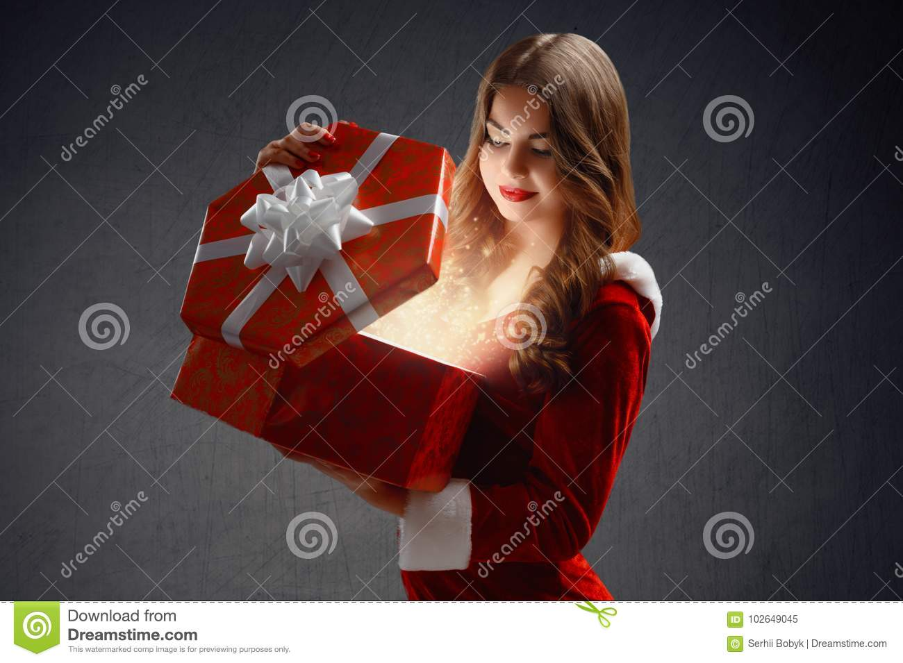 Beautiful Girl In A Red Suit Of Snow Maiden Opens A Gift For New ...