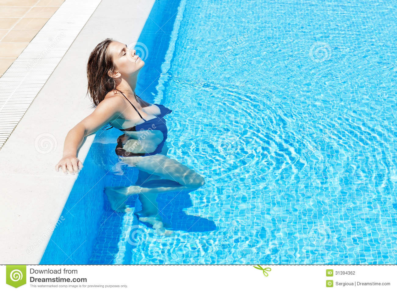 Beautiful girl relaxes in the pool in the summer outs for Pool photoshoot ideas