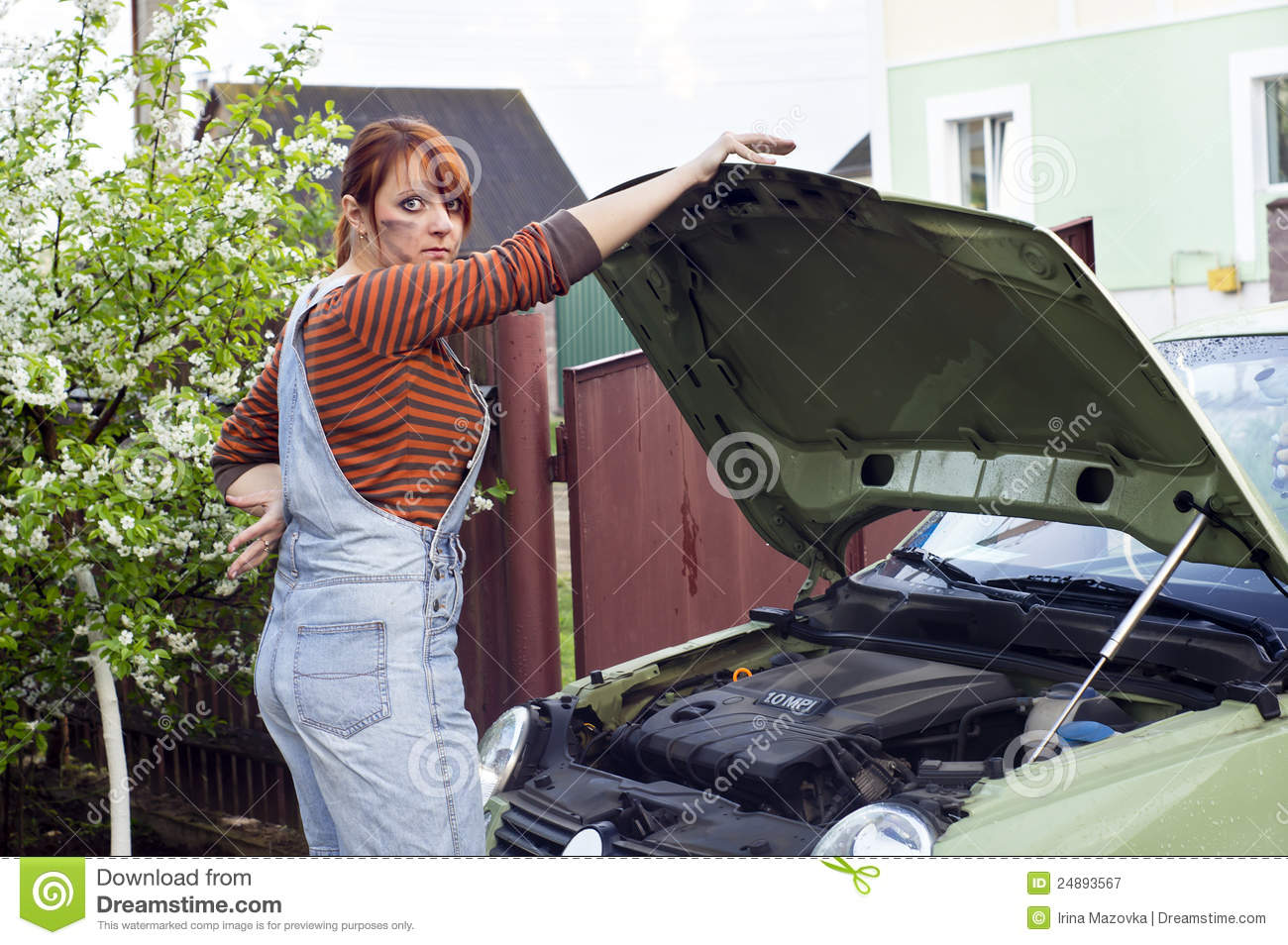 Beautiful girl repairing a car
