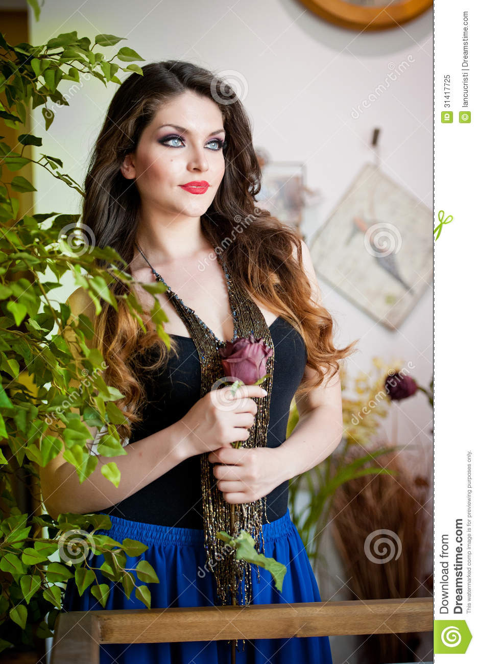 A Beautiful African: Beautiful Girl With A Rose In Hand In A Vintage Scene