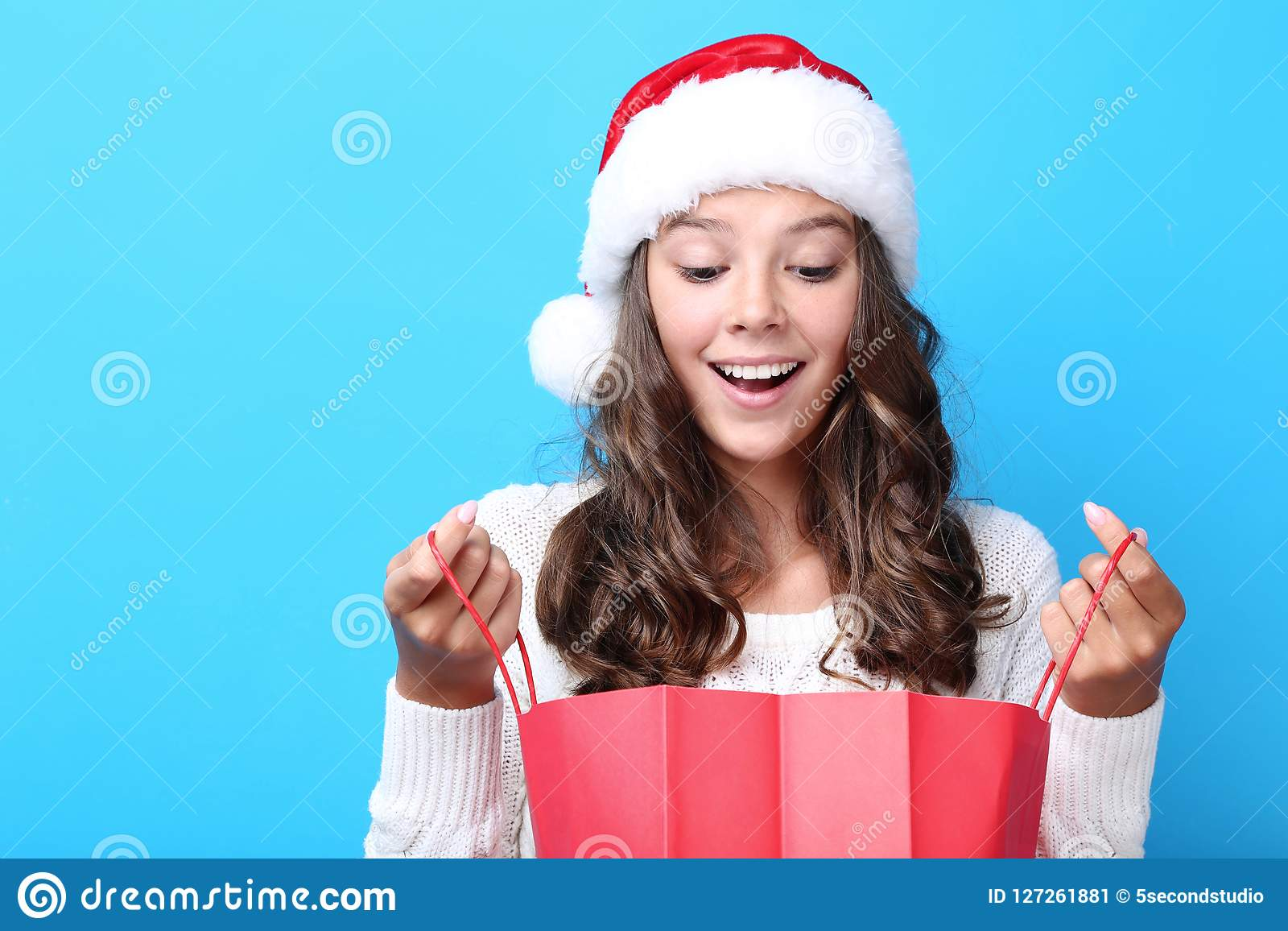 a9b38420430b7 Girl In Santa Hat Holding Shopping Bag Stock Image - Image of color ...