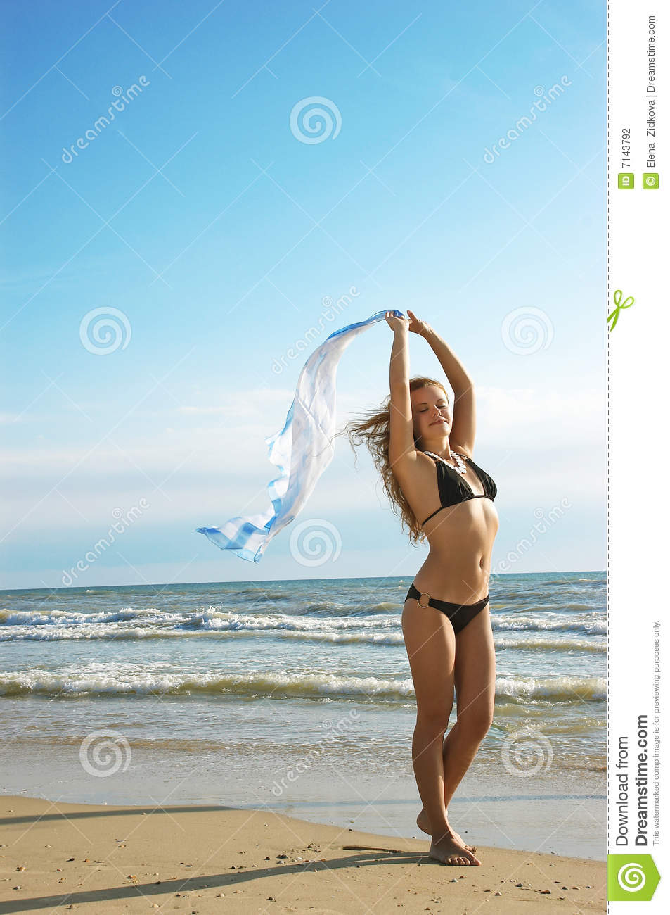 Beautiful Girl Sensually Stands On A Beach Stock ...