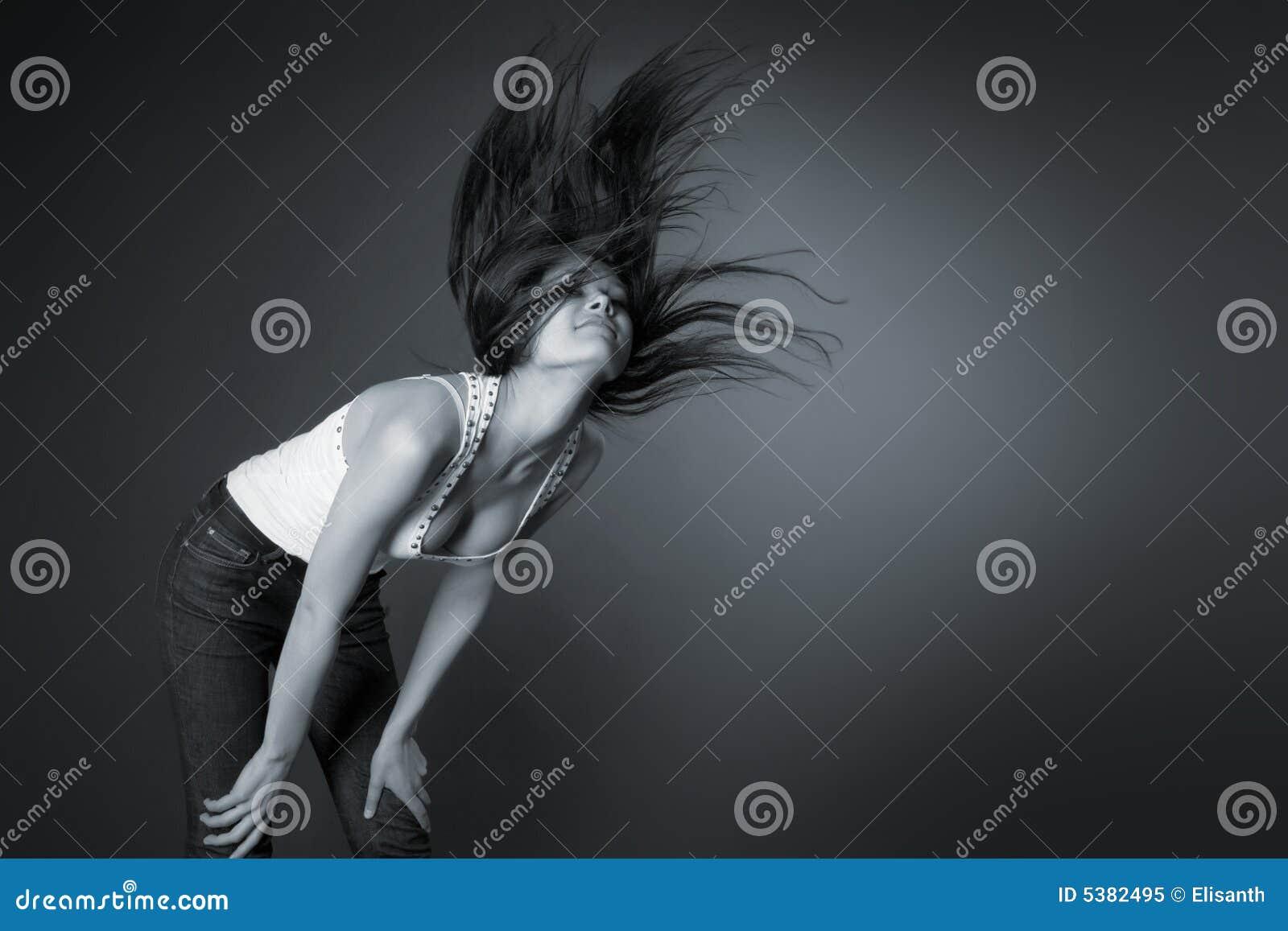 Beautiful girl shaking her head, monochrome