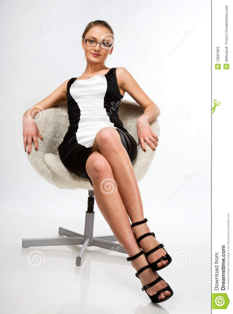 A Beautiful Girl Sitting On A Chair Stock Photos Image