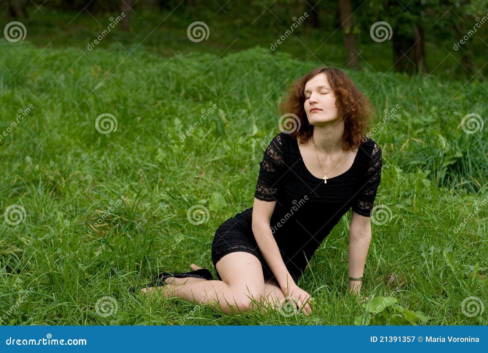 girl sitting on grass