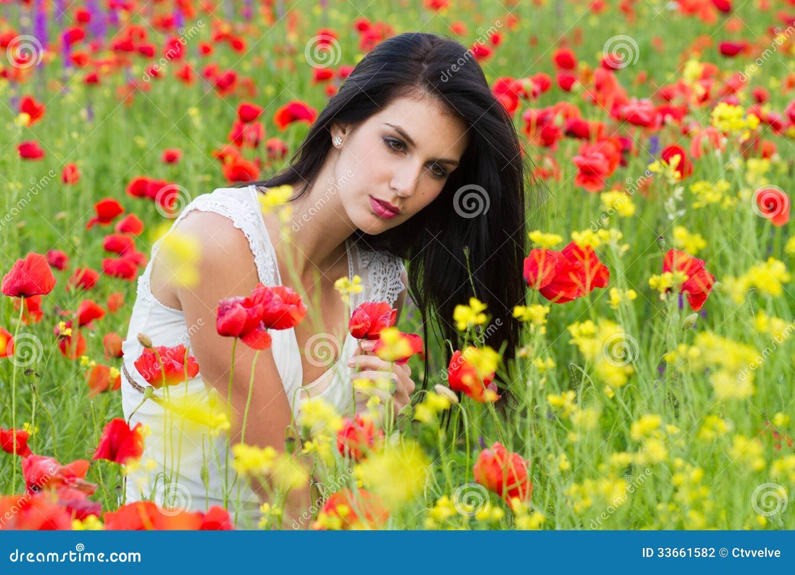 Beautiful girl sitting in the poppy flower field stock photo image beautiful girl sitting in the poppy flower field izmirmasajfo