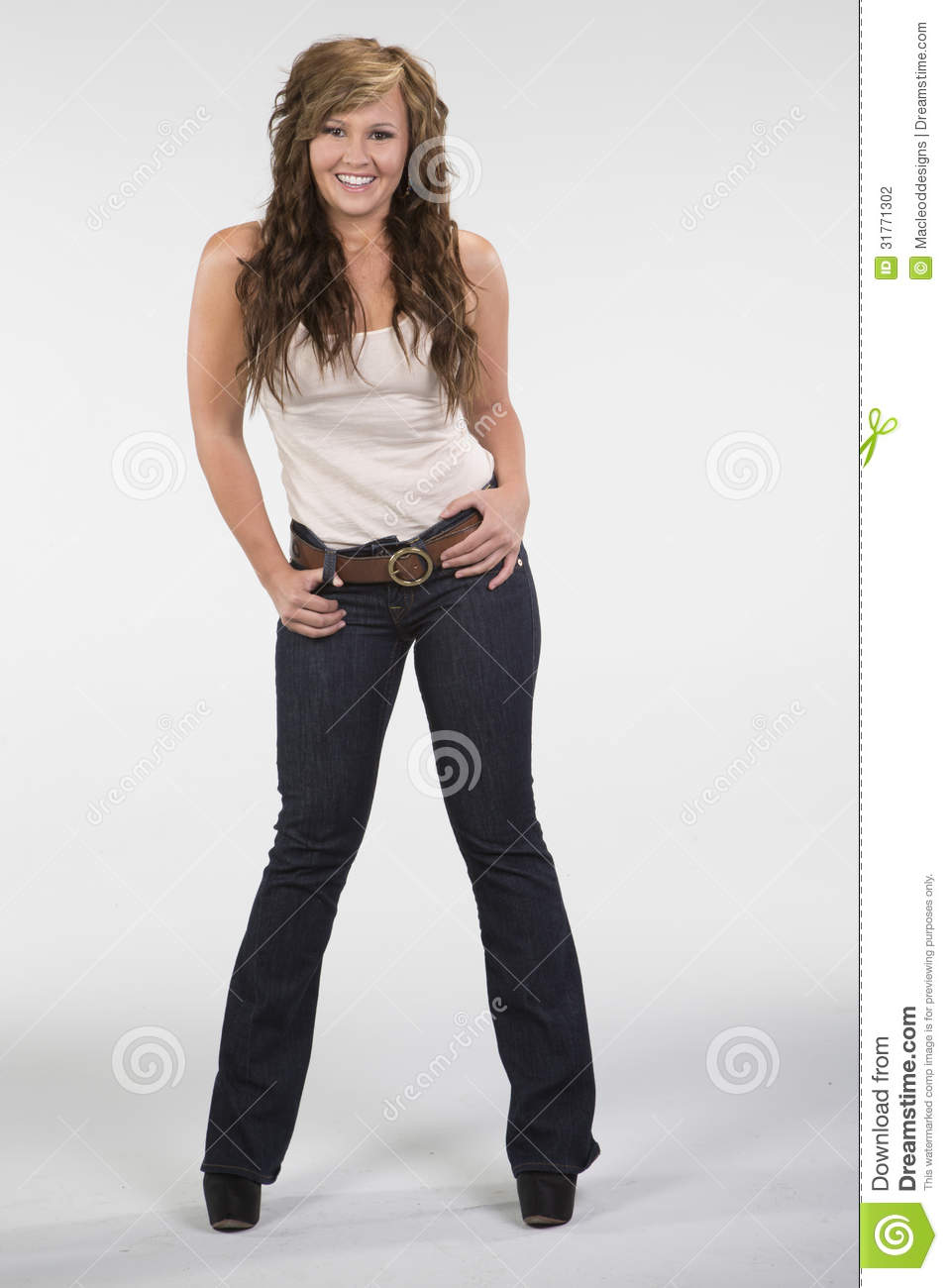 Beautiful Girl Smiling In Tan Shirt And Jeans Stock