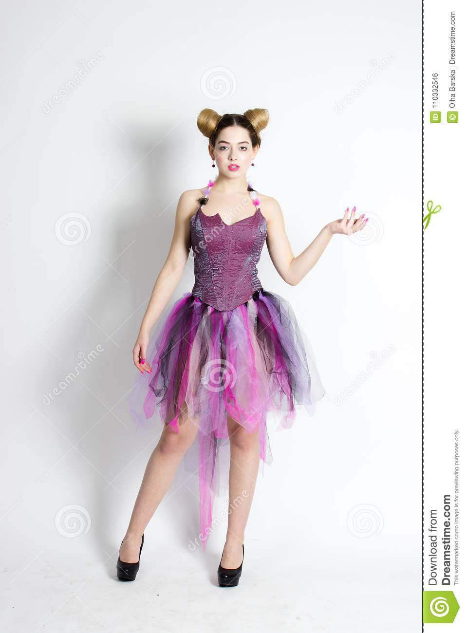 0c980aaf6752 A Beautiful Girl, Standing In A Doll Suit, Wearing A Dress And Heels ...