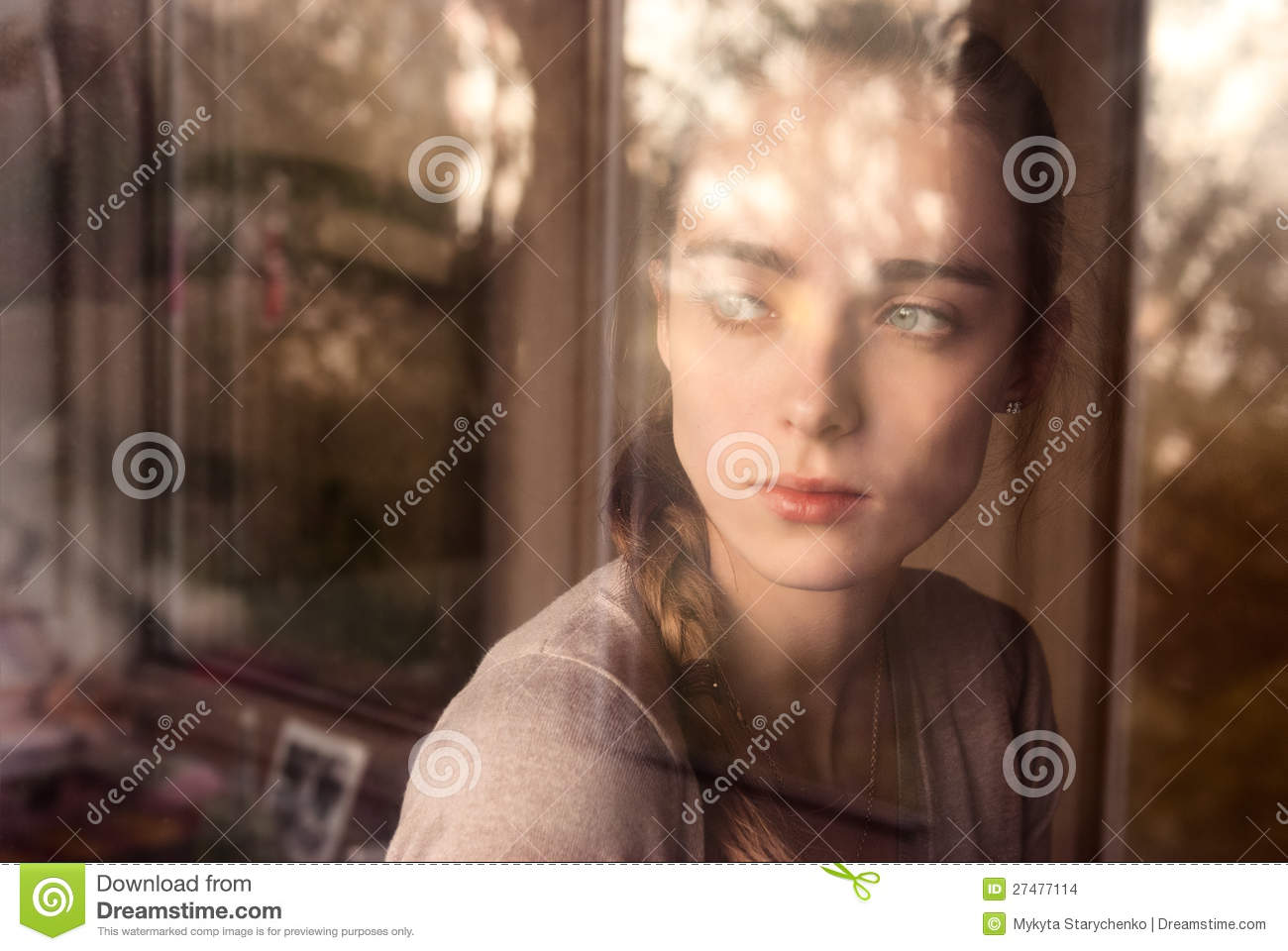 girl in the window At the far end of the room, beneath the wide window, the girl curled into the corner of the couch her bare feet were tucked beneath baggy sweat pants her honey hair hung across her eyes.