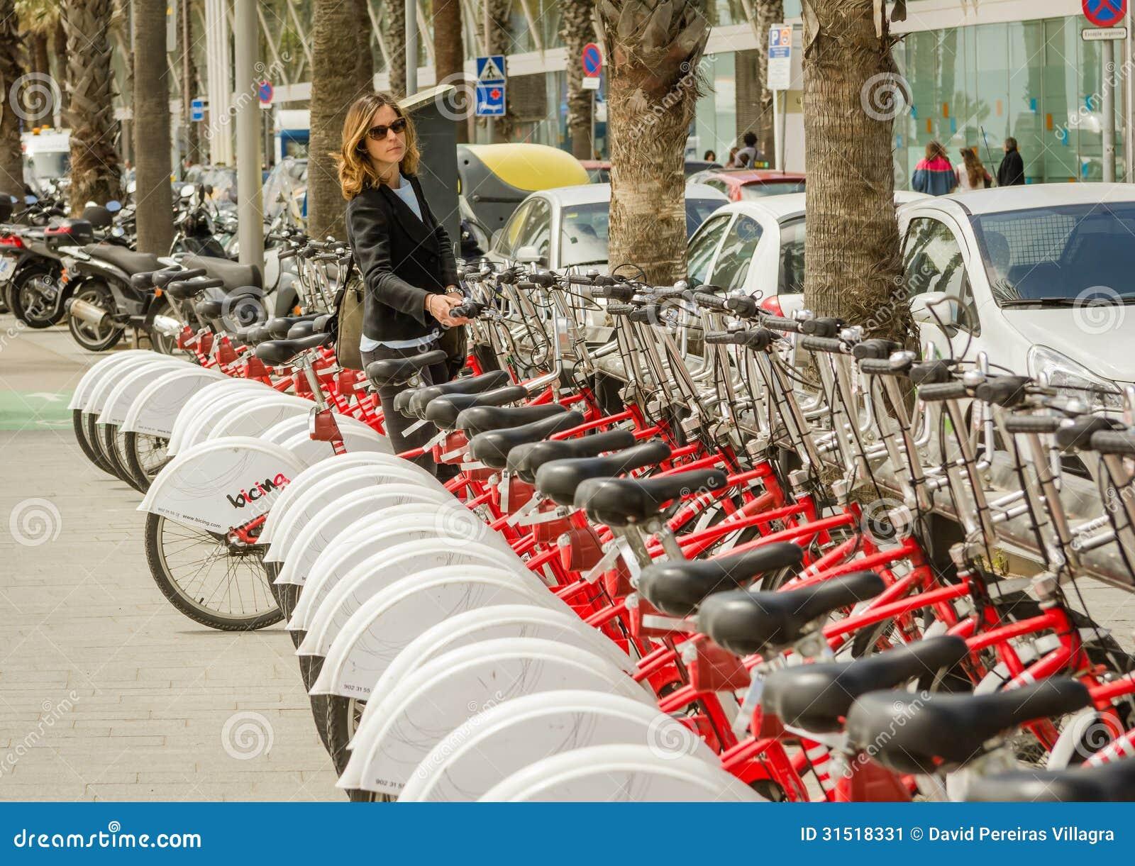 Beautiful Girl Taking A Bike Of Row On The Street, In ...
