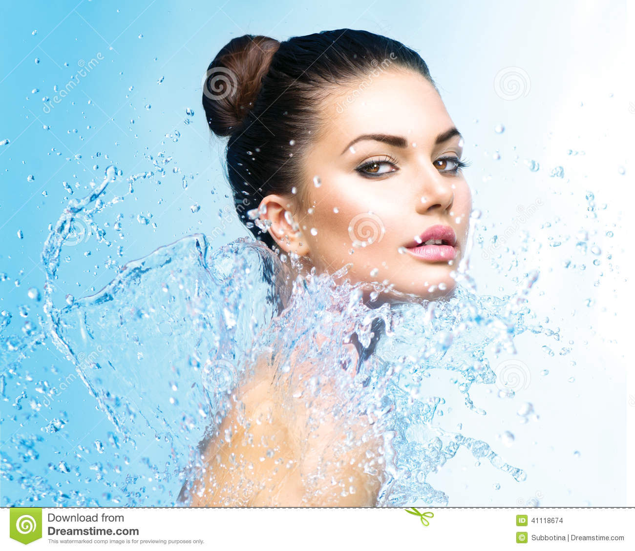 Beautiful girl under splash of water