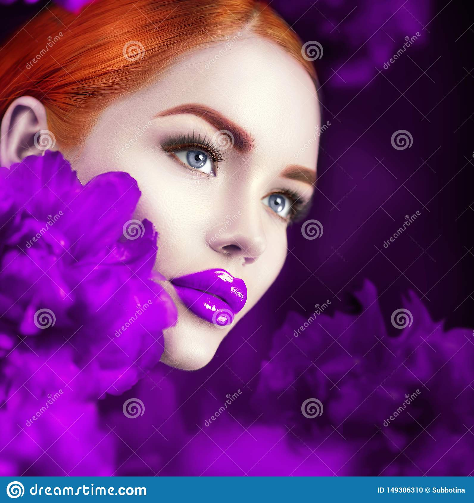 Beautiful girl with violet peony flowers portrait. Beauty fashion redhead model woman face