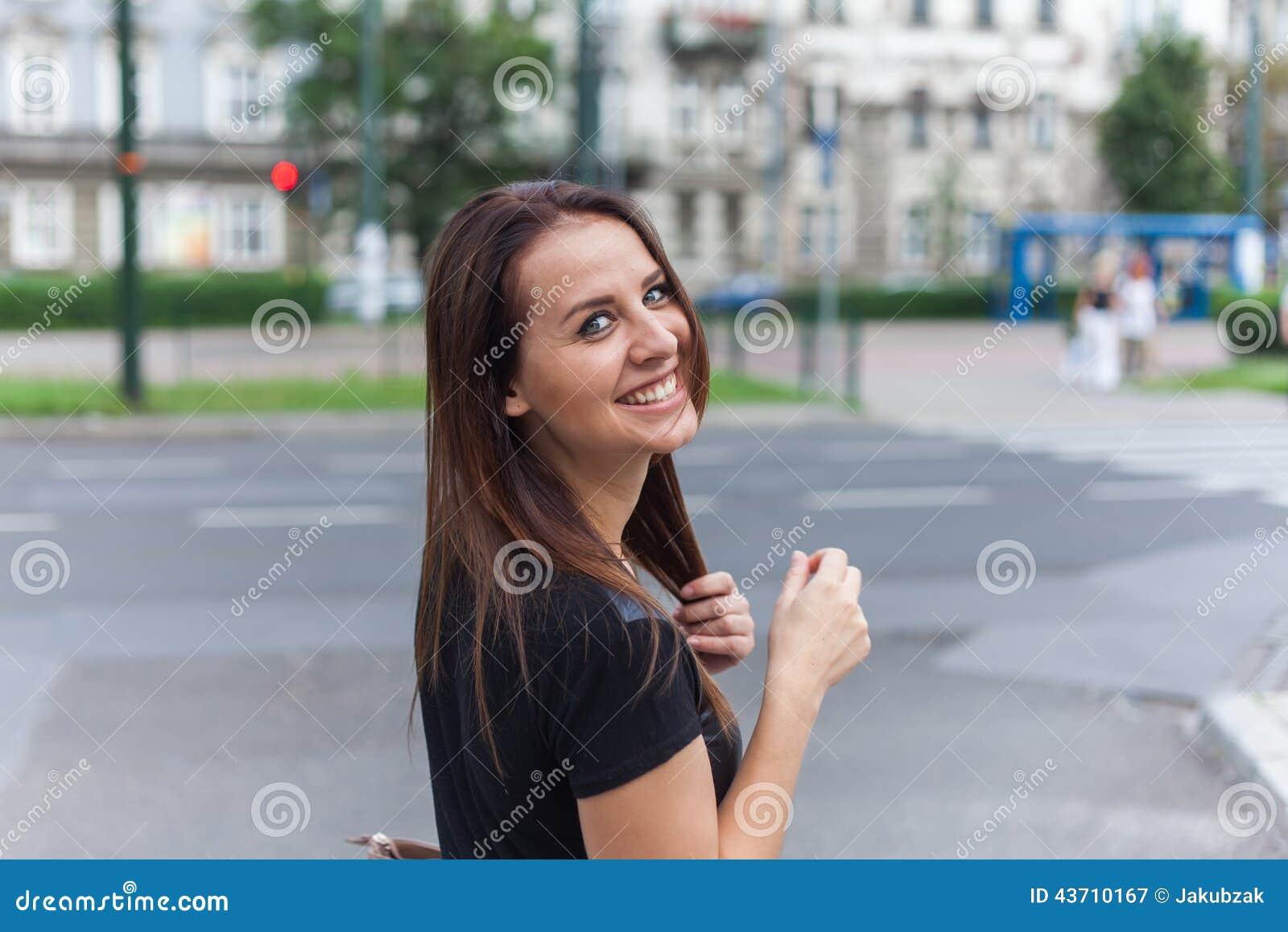 beautiful teen walking on street