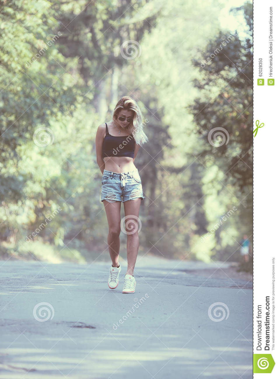 Beautiful Girl Walking Down A Forest Road Stock Image
