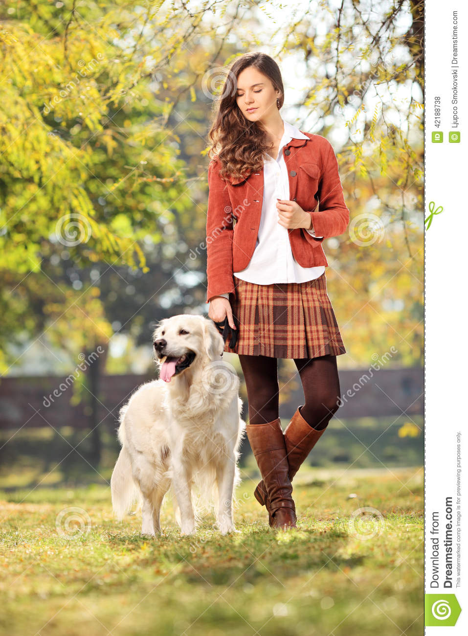Beautiful Girl Walking Her Dog In Park Stock Photo Image Of