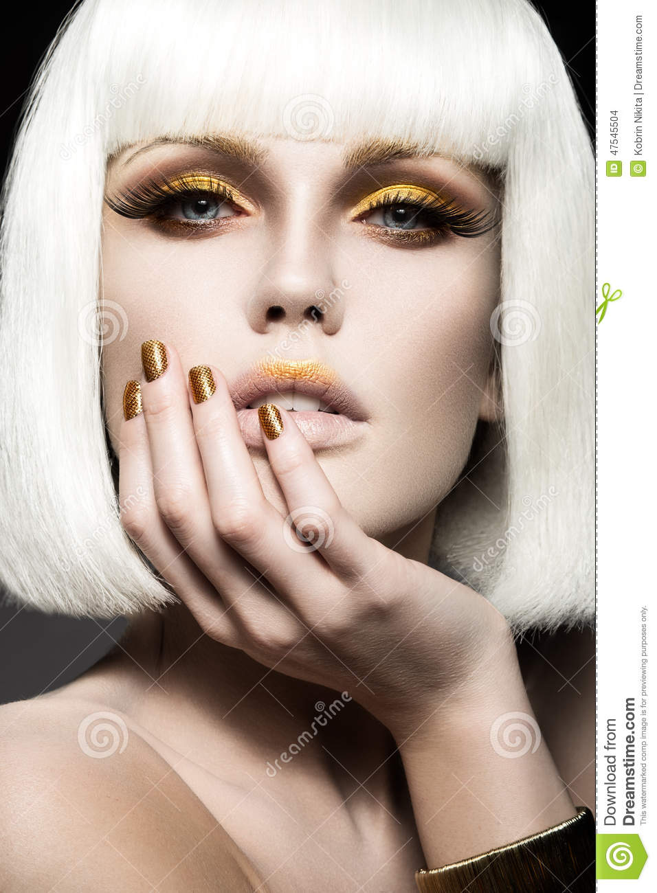 Girl Makeup: Beautiful Girl In A White Wig, With Gold Makeup And Nails
