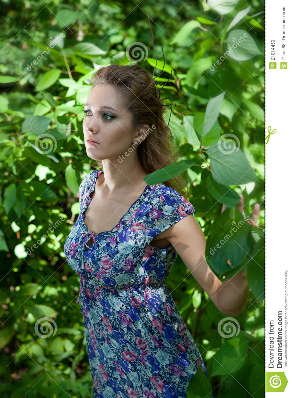 Beautiful Girl In The Woods Around Green Leaves