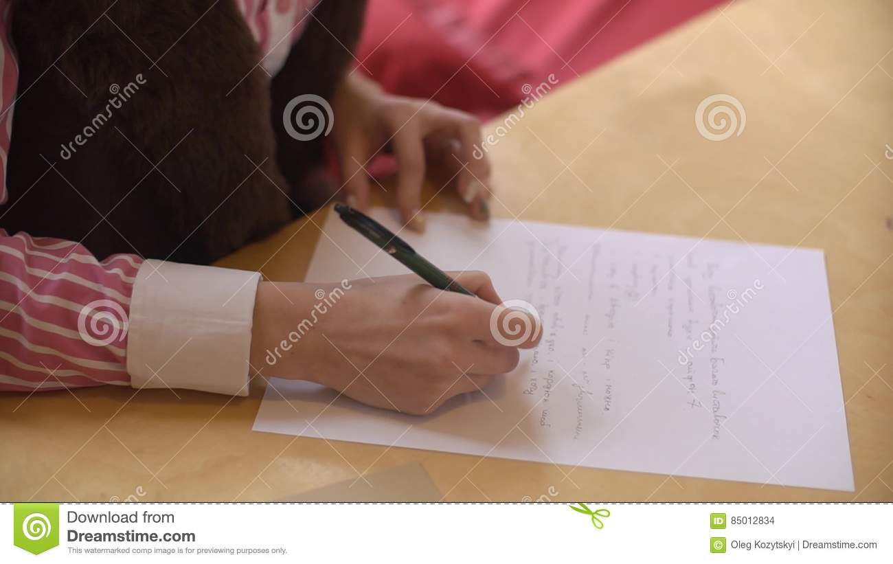 Beautiful Girl Write Letter To Friend At The Table CloseUp Stock