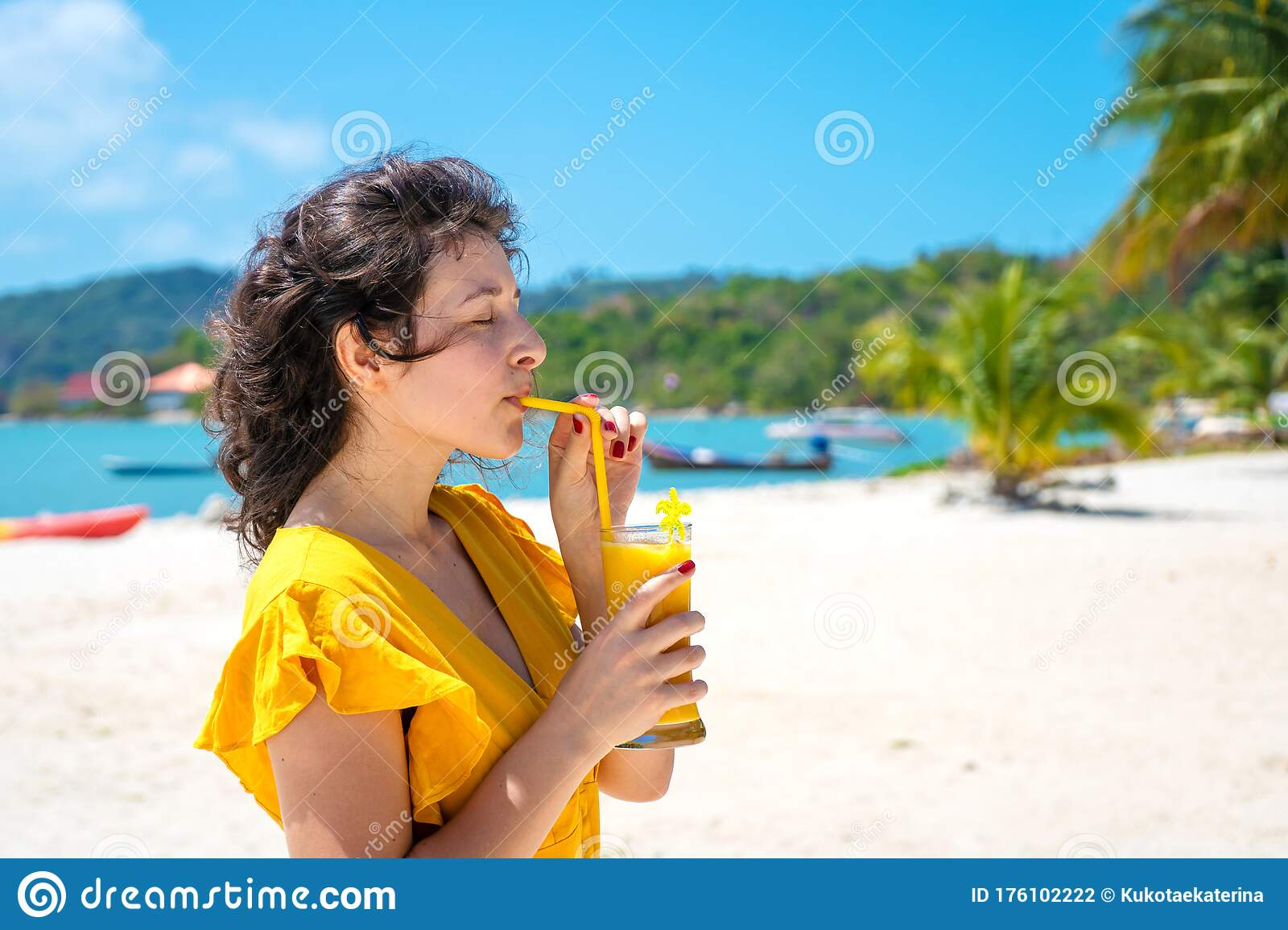 Beautiful Girl In A Yellow Dress Drinks Fresh Mango On The Beach Of A Paradise Island Perfect Vacation Stock Photo Image Of Cocktail Caucasian 176102222