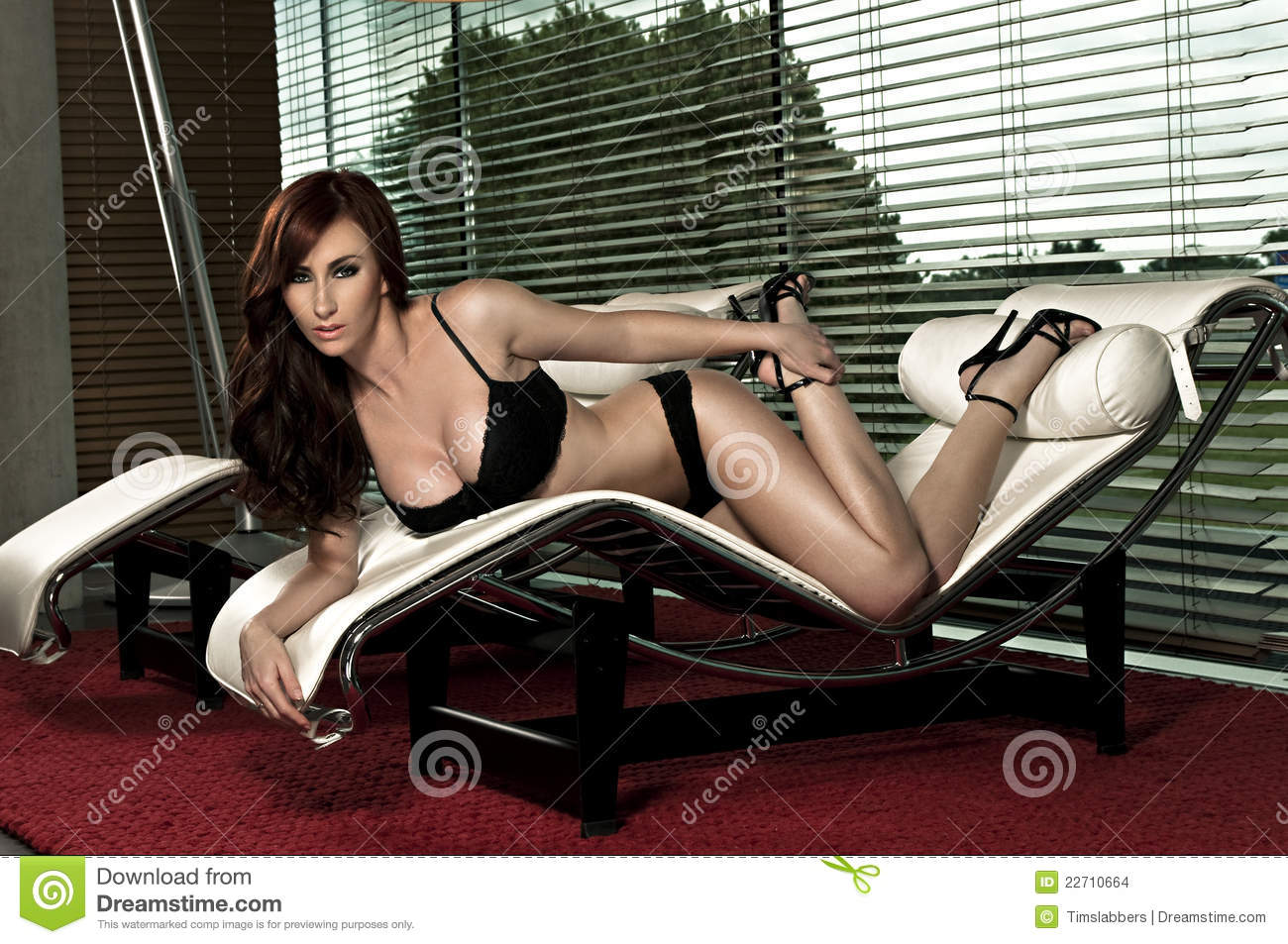 Beautiful Glamour Girl On Lounge Chair Royalty Free Stock