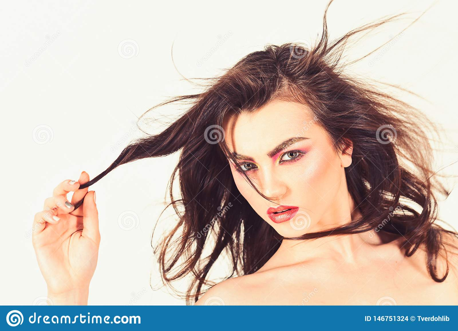 A beautiful and glamour hair look. Pretty woman wear long and wavy hair. Styling hair. woman with perfect makeup