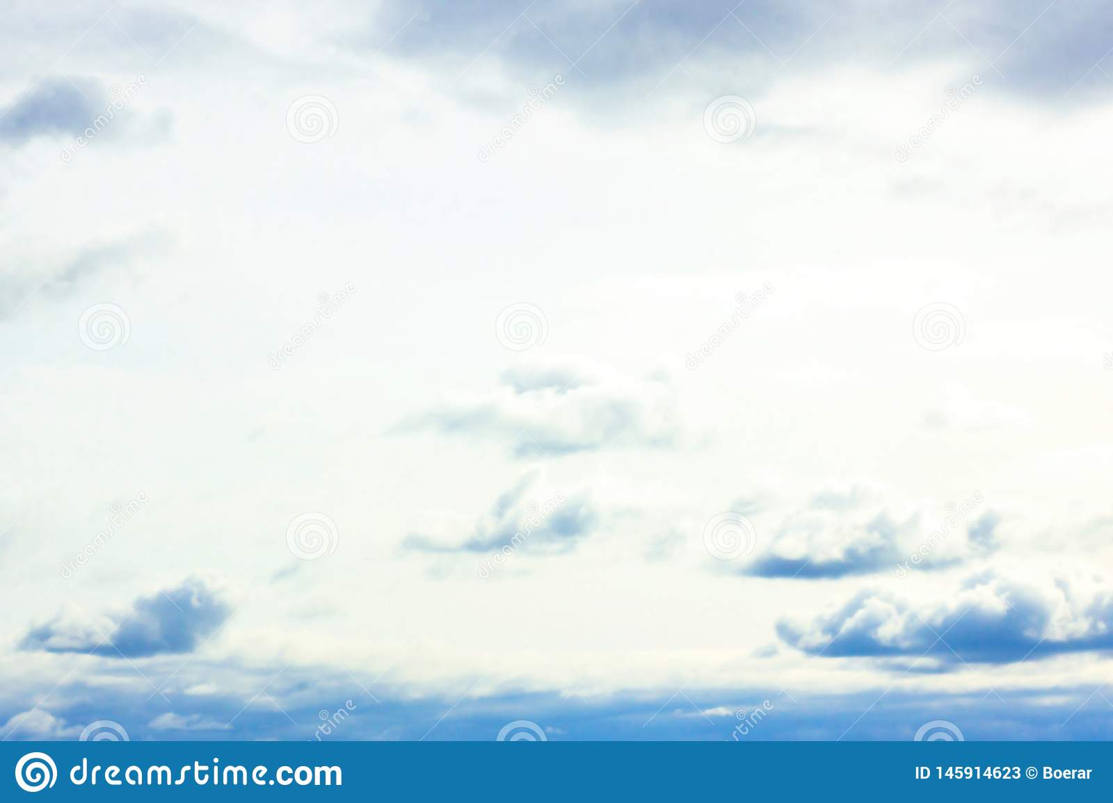 Beautiful gloomy blue sky with fluffy clouds in summer morning peace day as background