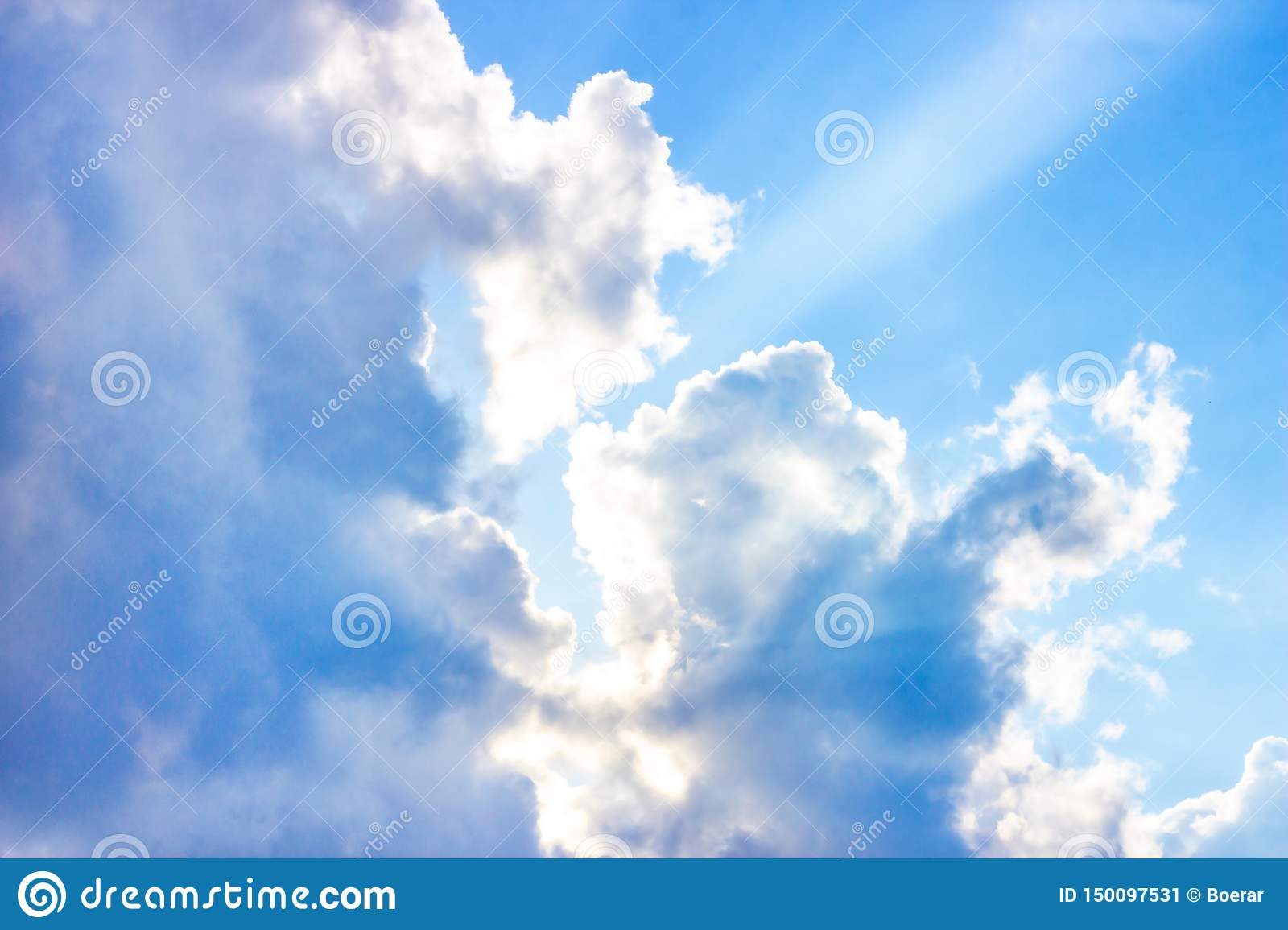 Beautiful gloomy blue sky with fluffy clouds in summer morning peace day as a background
