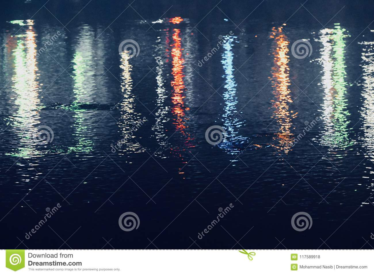 Download Colourful Street Lights Reflection In Water Blurred Photograph Stock Photo - Image of night, stylish: 117589918