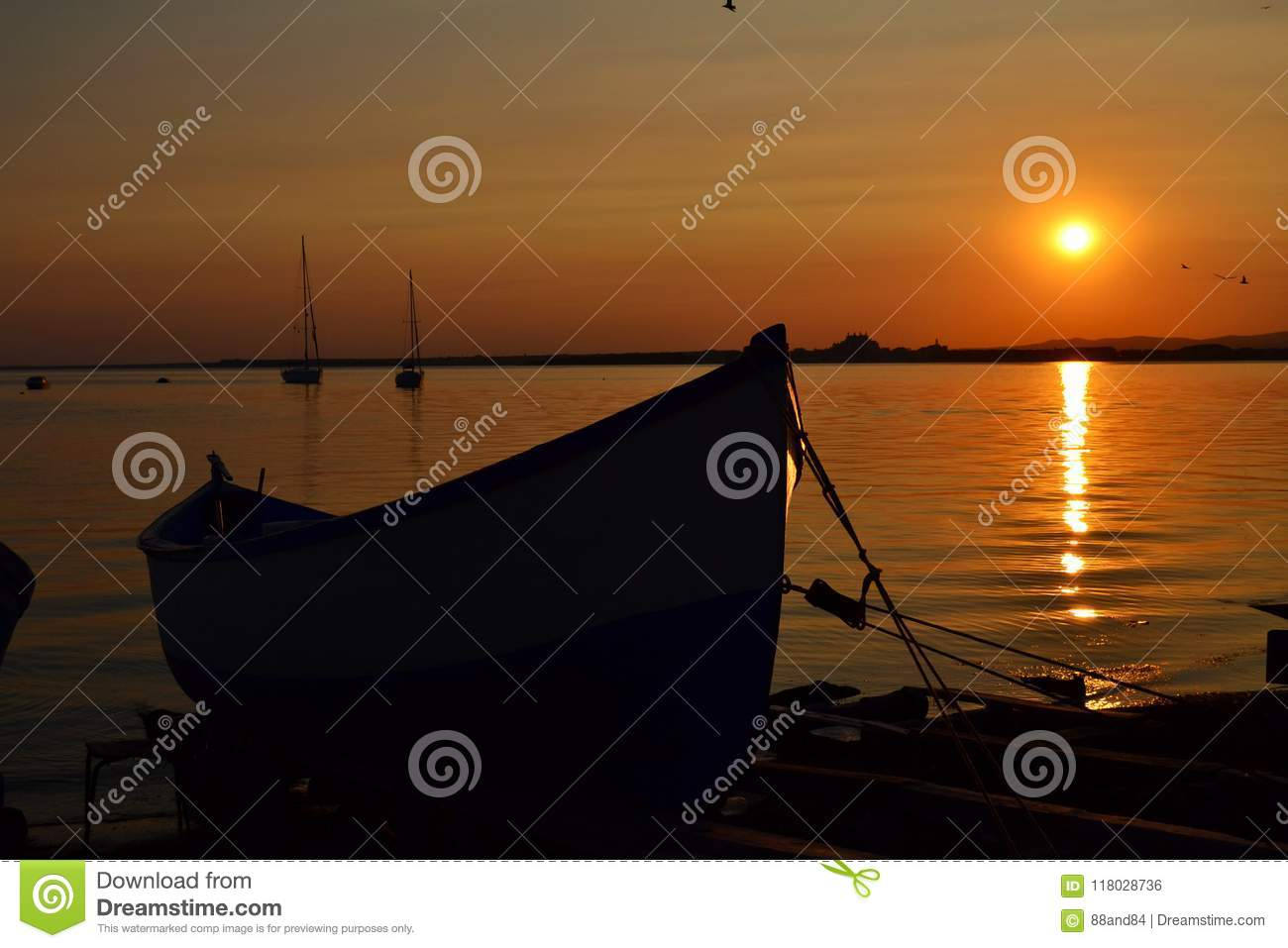 Beautiful Golden Sea Sunset with Fish Boats
