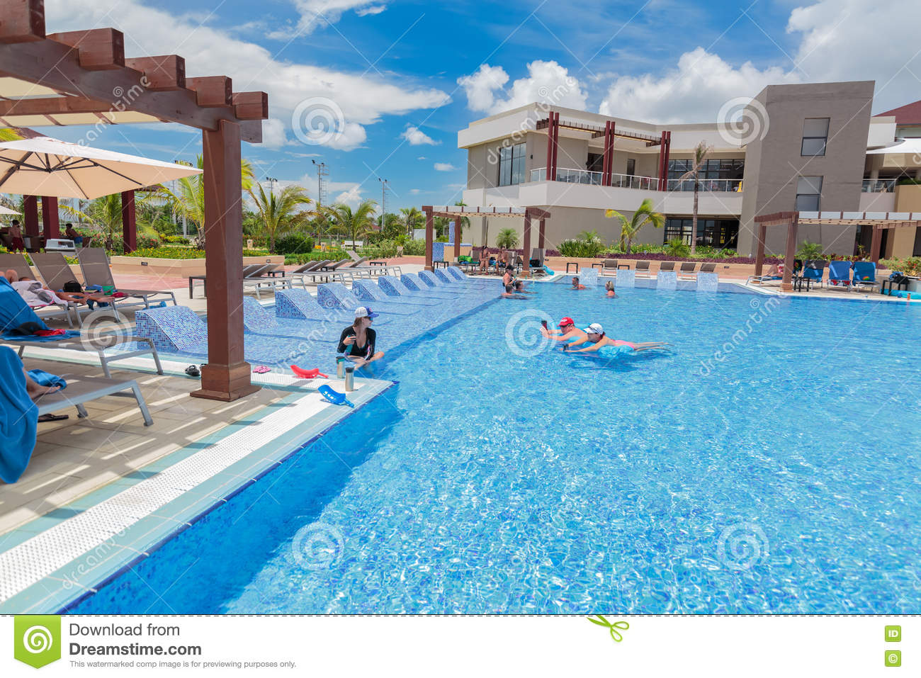 Inviting Gorgeous Stunning View Of Hotel Grounds With Cozy Comfortable Swimming Pool Editorial