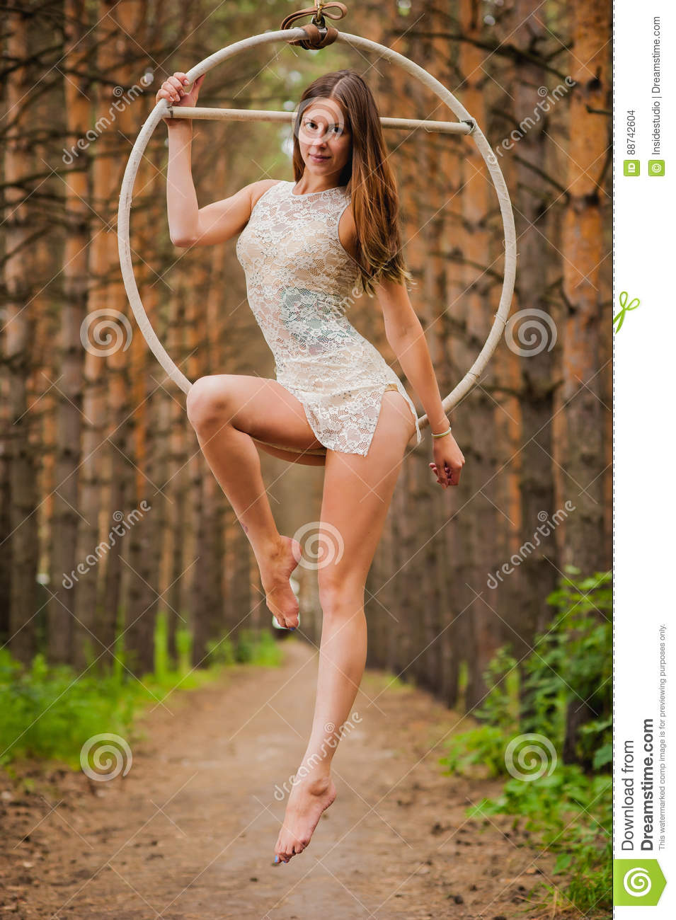 Beautiful And Graceful Aerial Gymnast Performs Exercises On The ...