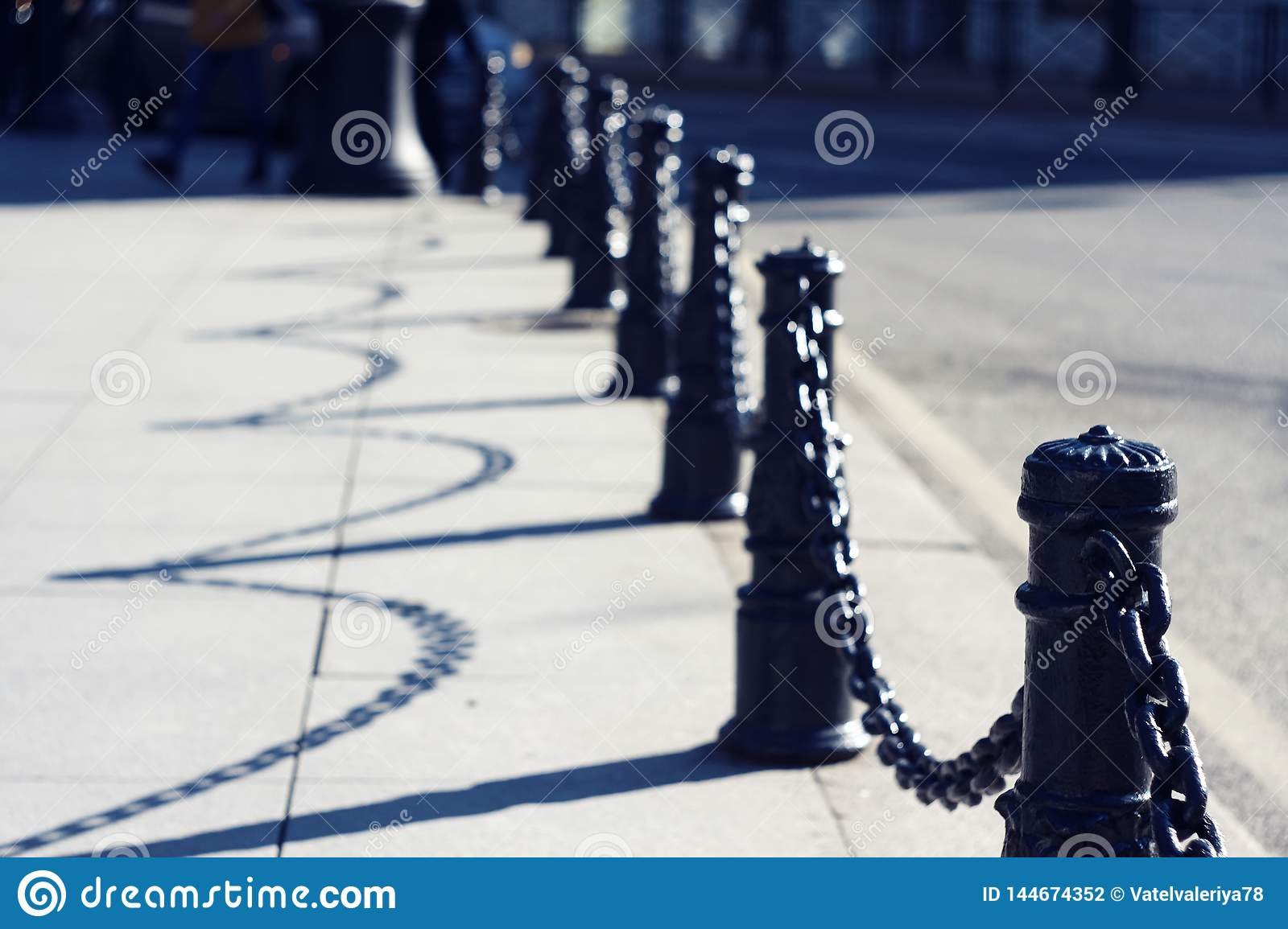 Beautiful graceful black decorative fence with chains