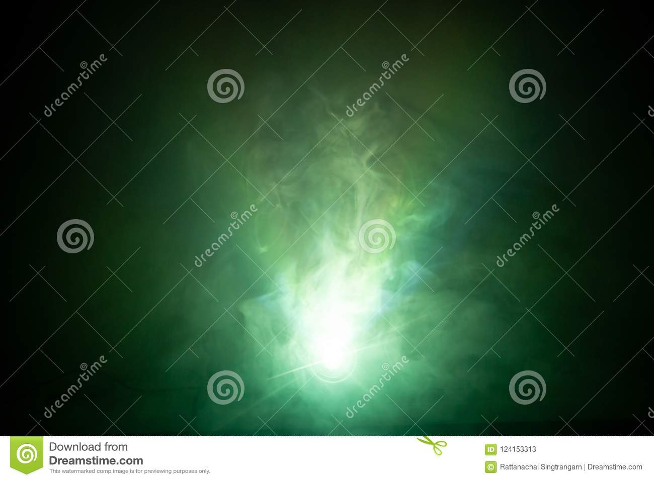 Beautiful green color light beam at night . smoke texture spotlight . screening abstract background .